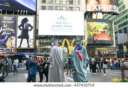NEW YORK, USA - APRIL 15, 2016 : Statue of liberty impersonator in Times Square, Times Square is a major commercial intersection in Manhattan, at the junction of Broadway and 7th Ave. - stock photo