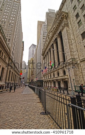 NEW YORK, USA - APRIL 24, 2015: Street view of New York Stock Exchange on Wall Street, Lower Manhattan, USA. It is called NYSE in short. Tourists in the street - stock photo