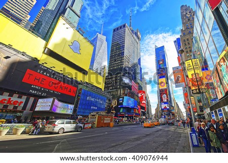 New York, USA - April 25, 2015: Streets of Broadway and 7th Avenue in Times Square. Skyscrapers in Midtown Manhattan in New York, USA. Tourists in the street - stock photo