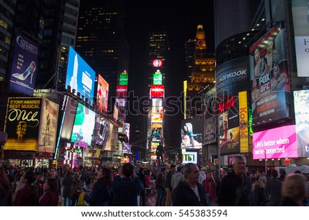 NEW YORK, USA - APRIL 2013: Times Square, crowds of tourists, illuminated advertising.