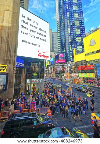 New York, USA - April 25, 2015: Tourists crossing street in Times Square in New York. Skyscrapers in Midtown Manhattan in New York, USA.