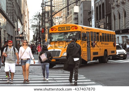 NEW YORK, USA - APRIL 15, 2016 : Yellow school school bus in Manhattan on his way to picking up pupils