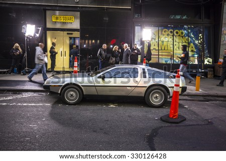 NEW YORK, USA - AUG 21, 2015:  people admire the famous original amc chrome car from the film back to the future presented at time square due to 25th anniversary of the Hollywood film. - stock photo