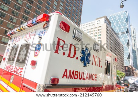 NEW YORK, USA - AUGUST 20, 2014: FDNY Ambulance in Manhattan providing first aid to injured people - stock photo