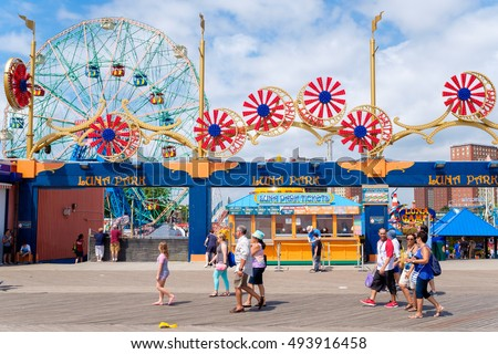 NEW YORK,USA - AUGUST 18,2016 : Ferris wheel and carrousel at the Luna Park amusement park at Coney Island