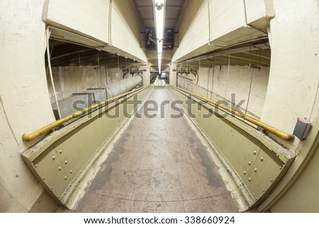 NEW YORK, USA - AUGUST 15, 2015: Fisheye lens photo of a ramp in Grand Central Terminal, first station to largely eliminate staircases by use of ramps to more efficiently accommodate pedestrian flows. - stock photo