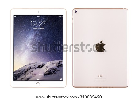 New York, USA - August 26, 2015: Front and back view of white Apple iPad Air 2, 6th generation of the iPad, developed by Apple inc. and was released on October 16, 2014 - stock photo
