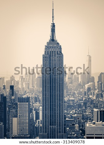 NEW YORK,USA- AUGUST 15 : New York City with the Empire State Building on the foreground - stock photo