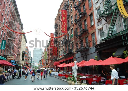 New York, USA - August 19, 2012: street scene with people and restaurants in Little Italy in New York City. The area known for its Italian heritage & culture attracts many tourists. - stock photo