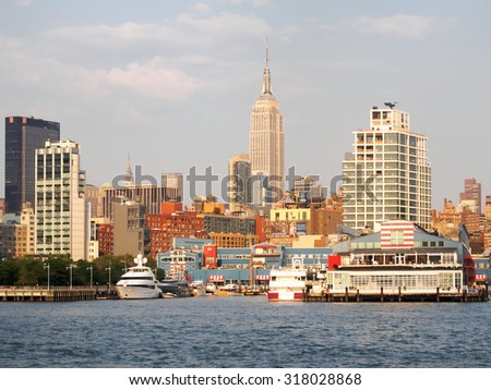 NEW YORK,USA - AUGUST 16,2015 : The docks at the Hudson river with the Empire State Building on the background - stock photo