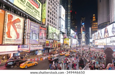 NEW YORK, USA - AUGUST 18, 2015: Times Square crowded with tourists at night with Broadway Theaters and animated LED signs.