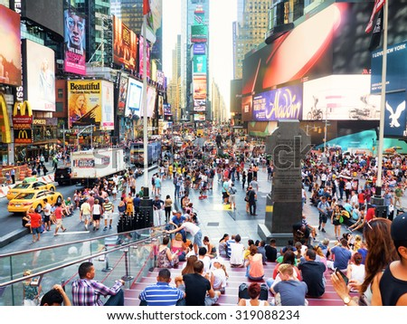 NEW YORK,USA - AUGUST 14,2015 : Tourists and colorful neon billboards at Times Square in New York City - stock photo