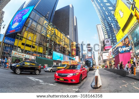 NEW YORK,USA - AUGUST 14,2015 : Traffic and neon lights at Times Square in New York City