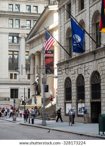 NEW YORK,USA - AUGUST 13,2015 : View of Wall Street and the Federal Hall in Manhattan