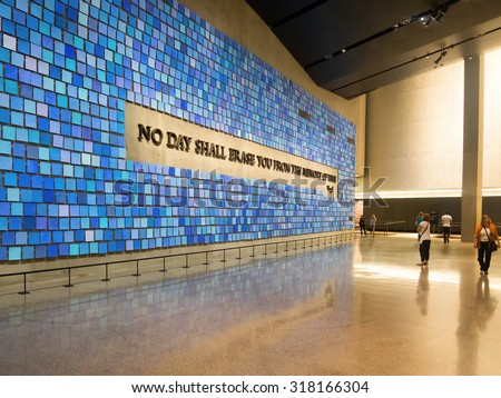 NEW YORK,USA - AUGUST 14,2015 : Visitors at the 9/11 Memorial Museum in New York City - stock photo
