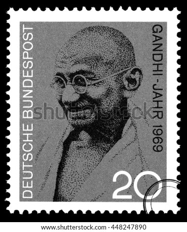 New York - USA - Circa 2010: A postage stamp printed in Germany showing a portrait of the famous Indian Mohandas Karamchand Gandhi, circa 2004 - stock photo