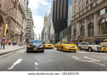 NEW YORK, USA - CIRCA MAY 2015: Vehicles move along 5th Avenue in New York City. - stock photo