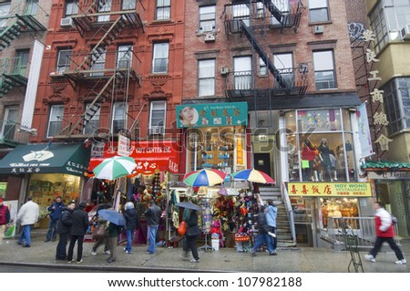 NEW YORK, USA - DECEMBER 23: Chinatown on December 23, 2007 in New York: New Yorkers and tourists walking in Chinatown. Chinatown is one of the busiest areas and offers a shops and services. - stock photo