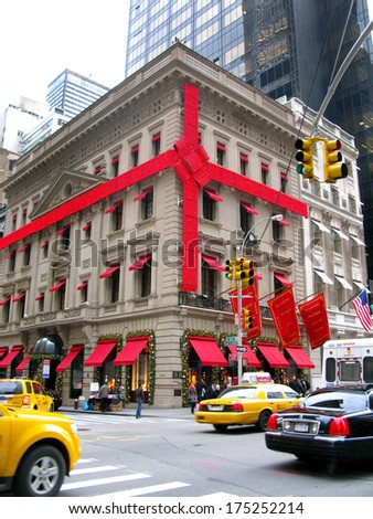 NEW YORK, USA - DECEMBER 3: Luxury shop decorated as a Christmas gift,  in 5th Avenue, where the most expensive stores of Manhattan are located. New York City, USA, 3rd December 2010 - stock photo