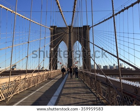 New York, USA - December 4, 2015: Sunny day on famous Brooklyn bridge in New York City.