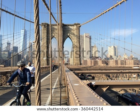 New York, USA - December 10, 2015: Sunny day on famous Brooklyn bridge in New York City.