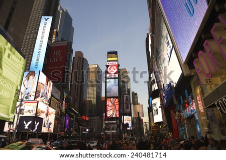 NEW YORK, USA - DECEMBER 27, 2014: The lights of Times Square draw crowds in the build-up to New Year's Eve. - stock photo