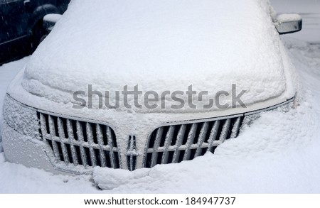NEW YORK, USA - FEB 16:A Lincoln luxury car buried under layers of snow during severe snow storm on February 16, 2014 in New York, USA