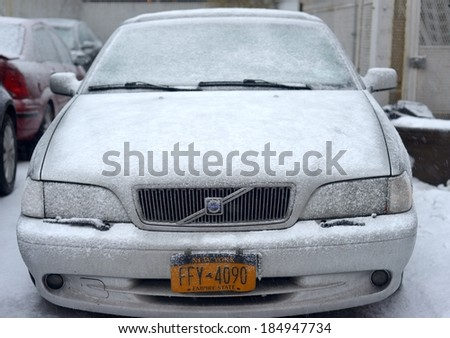 NEW YORK, USA - FEB 16:A Volvo luxury car buried under layers of snow during severe snow storm on February 16, 2014 in New York, USA