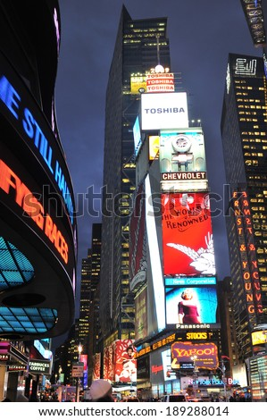 NEW YORK, USA - FEB 11, 2009: Times Square at night time. Times Square is a popular touristic attraction in New York City. - stock photo