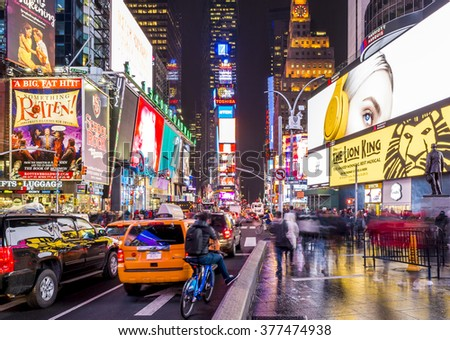 NEW YORK, USA - FEBRUARY 12: The architecture of the famous Times Square in New York city, USA with its neon lights and panels at night and a lot of tourists passing by on February 12, 2016.