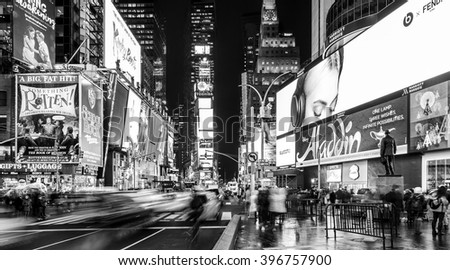 NEW YORK, USA - FEBRUARY 12: The modern architecture of the famous Times Square in New York city, USA with its neon lights at night with a lot of tourists and locals passing by on February 12, 2016. - stock photo