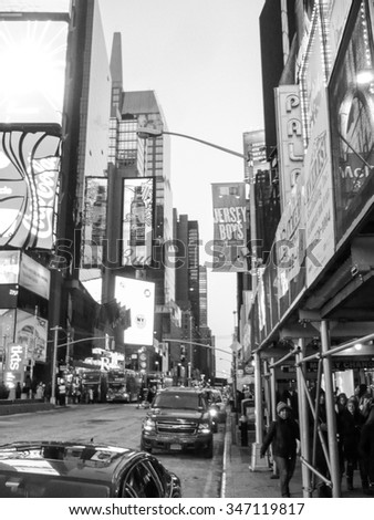 NEW YORK, USA - FEBRUARY 15, 2015: Times Square in Midtown Manhattan is a major commercial intersection at the junction of Broadway and Seventh Avenue in black and white