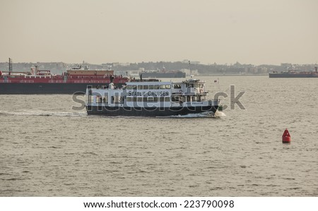 NEW YORK, USA - January 9: Cruise Ship in New York on January 9, 2011.  A short cruise sails from Midtown and New Jersey out to Liberty Island for a close-up look at Statue of Liberty and Ellis Island - stock photo