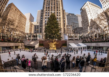 NEW YORK, USA - JANUARY 10: Locals and tourist watching and doing ice skating at one of the most traditional tourist attractions of New York city, the Rockefeller Center Compound on January 10, 2013. - stock photo
