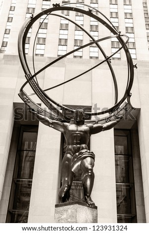 NEW YORK, USA - JANUARY 5: The historic Atlas Statue in the Rockefeller Center stands for power in the Fifth Ave where is located the most expensive retail stores of New York city on January 5, 2013. - stock photo