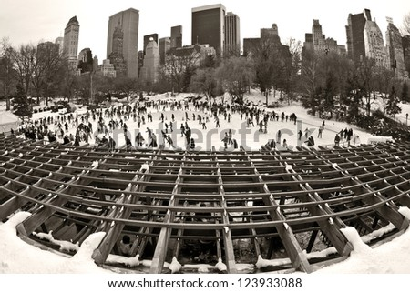 NEW YORK, USA - JANUARY 5: The traditional ice rink in Central Park continues to attracts hundreds of tourists and locals every winter to Manhattan as seen on January 5, 2013 in New York, USA. - stock photo