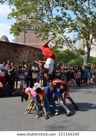 NEW YORK, USA - JULY 25: Acrobats in the street of New York at July 25, 2014. - stock photo