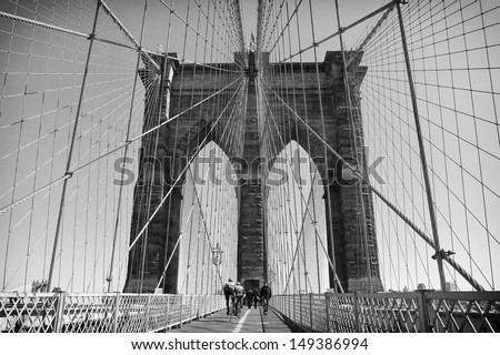 NEW YORK, USA - JULY 10: Brooklyn Bridge connects Manhattan to Brooklyn by a double deck, one used by pedestrians and the other by automobiles, as seen in this photo on July 10, 2009 in New York, USA.