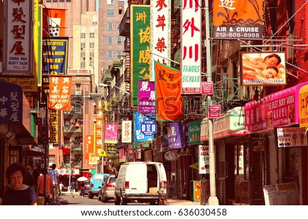 NEW YORK, USA - JULY 6, 2013: People visit Chinatown in New York. NYC Chinatown has an estimated population of 100,000 people and is one of oldest Chinatowns outside Asia.