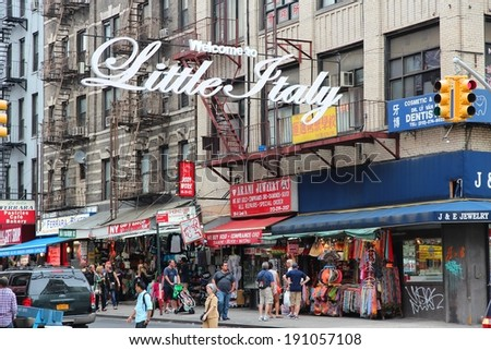 NEW YORK, USA - JULY 1, 2013: People visit Little Italy in New York. Little Italy is an Italian community in Manhattan. As many as 10,000 Italians lived there in 1910s (peak of Italian population). - stock photo