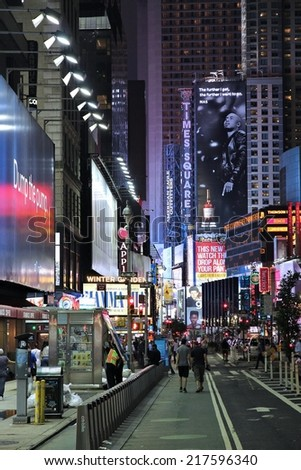 NEW YORK, USA - JULY 1, 2013: People visit Times Square in New York. Times Square is one of most recognized landmarks in the world. More than 300,000 people pass through Times Square daily. - stock photo
