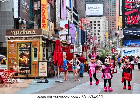 NEW YORK, USA - JULY 3, 2013: People visit Times Square in New York. Times Square is one of most recognized landmarks in the USA. More than 300,000 people visit Times Square every day. - stock photo
