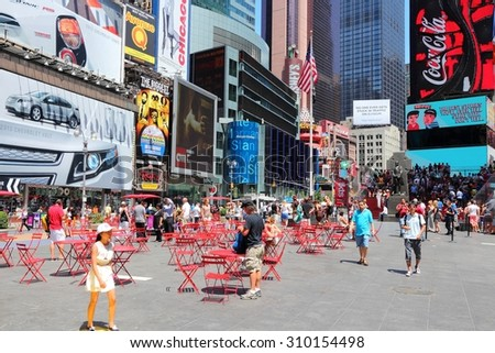 NEW YORK, USA - JULY 7, 2013: People visit Times Square in New York. Times Square is one of most recognized landmarks in the USA. More than 300,000 people visit Times Square every day.