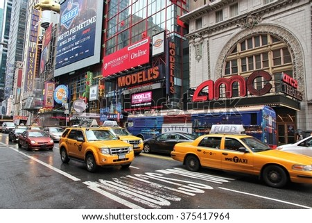 NEW YORK, USA - JULY 1, 2013: Taxis drive by Broadway Theaters in NY. AMC Theatres is a multiplex cinema.