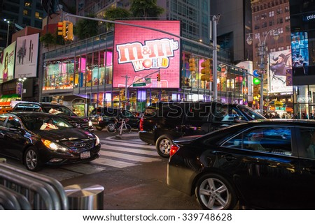 NEW YORK,USA-JULY 3,2015:Traffic in New York Times Square night scenes. The tourist landmark is visited by about 50 million tourists every year  - stock photo