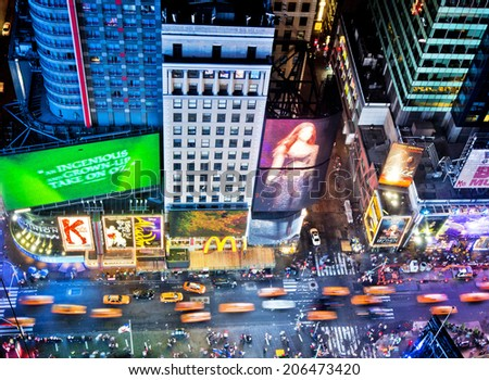 NEW YORK, USA - JUNE 29, 2014: Aerial view of Times Square the popular New Year's Eve destination with crowds and taxi cabs in motion in New York City. - stock photo