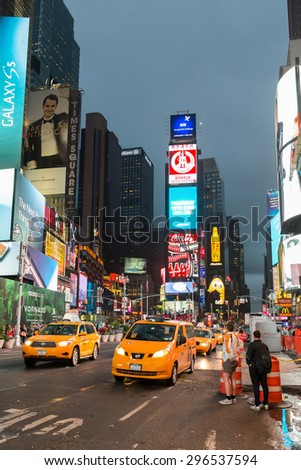 New York, USA - June 12, 2014: Illuminated city at night in Times Square, NY, USA - stock photo