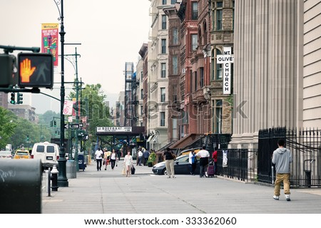 NEW YORK, USA - JUNE 16, 2015: Malcolm X Boulevard in Harlem district. Harlem is a large neighborhood within the northern section of New York City, known as a major African American residential center - stock photo