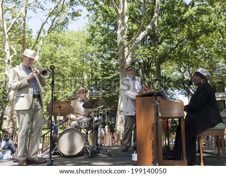 New York, USA - June 15, 2014: Musician playing on stage during 9th annual Jazz Age lawn party by Michael Arenella & the Dreamland Orchestra on Governors Island