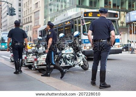 NEW YORK, USA - JUNE 14, 2014: NYPD officers on motorcycles providing security in Manhattan on June 14, 2014. New York Police Department, established in 1845, is the largest police force in USA - stock photo